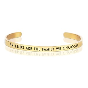 "Gold tone cuff bracelet stamped with ""Friends are the family we choose."""