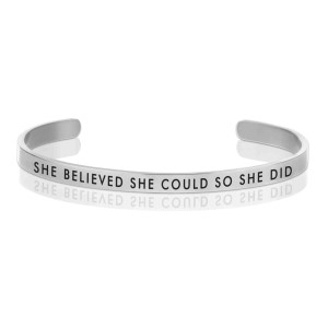 "Silver tone cuff bracelet stamped with ""She believed she could so she did."""
