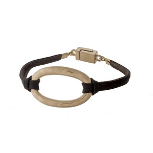 Brown, genuine leather magnetic bracelet with a hammered gold tone oval focal.