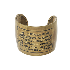 "Handmade, gold tone cuff bracelet stamped with The Serenity Prayer. Approximately 2"" in width."