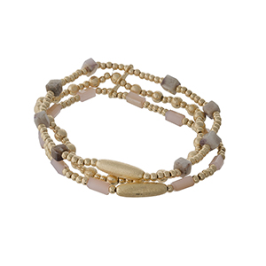 Gold tone and peach beaded, stretch bracelet set.