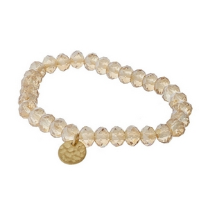 Champagne faceted bead stretch bracelet with a hammered gold tone circle charm.