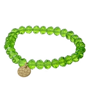 Green faceted bead stretch bracelet with a hammered gold tone circle charm.