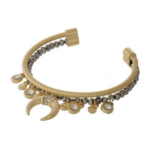 Gold tone and gray beaded cuff bracelet with a crescent charm and clear rhinestone accents.