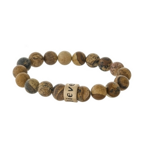 "Picture jasper, natural stone beaded stretch bracelet with a gold tone bead, stamped with ""Believe."""