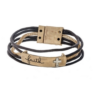 """Gold tone and brown cord bracelet featuring a bar stamped with """"Faith"""" and a magnetic closure."""