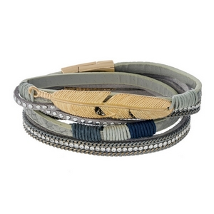 Gray faux leather wrap bracelet featuring a gold tone feather and a magnetic closure.