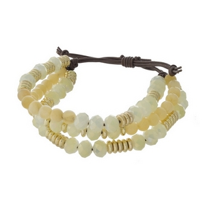 Three row, beaded pull-tie bracelet featuring yellow and pale yellow beads with gold tone accents. Handmade in the USA.