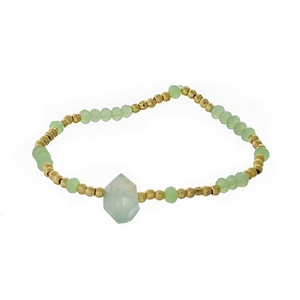 Light green and gold tone beaded stretch bracelet featuring a natural stone focal. Handmade in the USA.