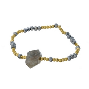Hematite and gold tone beaded stretch bracelet featuring a labradorite natural stone focal. Handmade in the USA.