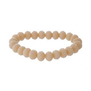 Pale peach beaded stretch bracelet.