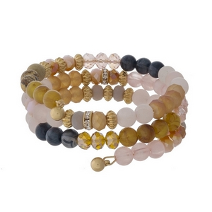 Rose Quartz, gray and topaz and brown beaded coil bracelet with gold tone accents.