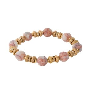Gold tone and light pink natural stone, beaded stretch bracelet with clear rhinestone accents.