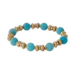 Gold tone and turquoise natural stone, beaded stretch bracelet with clear rhinestone accents.