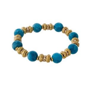 Gold tone and aqua natural stone, beaded stretch bracelet with clear rhinestone accents.