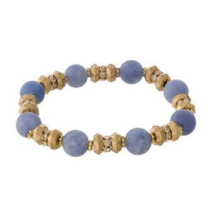 Gold tone and blue natural stone, beaded stretch bracelet with clear rhinestone accents.