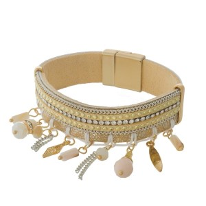 Brown, tan, and beige faux leather magnetic bracelet with ivory and peach beaded fringe.