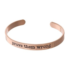 """Rose gold tone cuff bracelet stamped with """"prove them wrong."""""""