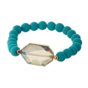 Turquoise beaded stretch bracelet with a topaz stone and gold tone accents.