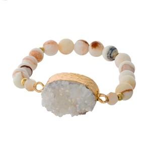 White beaded stretch bracelet with a white druzy stone focal.