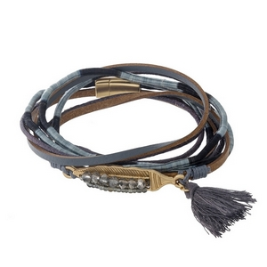 Black and brown leather wrap bracelet with a tassel accent and a magnetic closure.