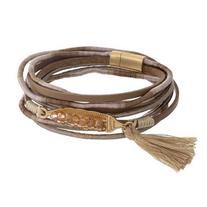 Brown and tan leather wrap bracelet with a tassel accent and a magnetic closure.