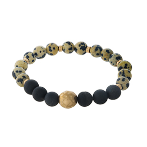 Dalmatian jasper natural stone beaded stretch bracelet with gold tone accents.