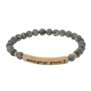 """Beaded stretch bracelet with a bar focal, stamped with """"amazing grace."""""""