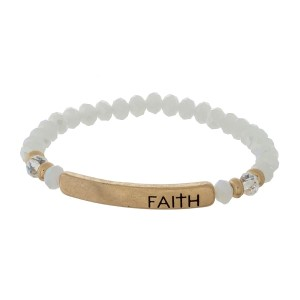 """Beaded stretch bracelet with a bar focal, stamped with """"Faith."""""""