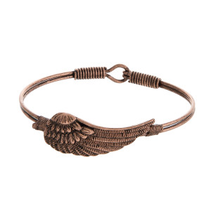 Burnished, bangle bracelet with a wing focal.