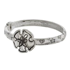 "Metal bracelet with wrist sea details. Approximate 7"" in diameter."