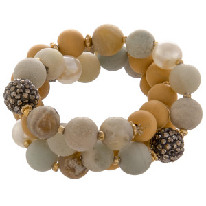 "Stretch bracelet with natural stone beads. Approximate 3"" in diameter."
