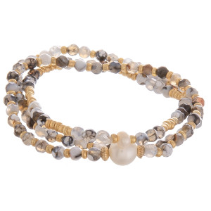 "Multi layered stretch bracelet with pearl detail. Approximate 6"" in diameter."