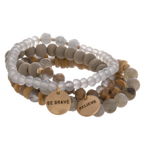 "Multi layered bracelet with natural stone, wood and bead detail. With message charms.  Be brave/ believe. Approximate 6"" in length."