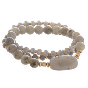 "Multi layered bracelet with natural stone and bead detail. Approximate 6"" in length."