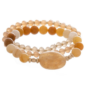 """Multi layered bracelet with natural stone and bead detail. Approximate 6"""" in length."""