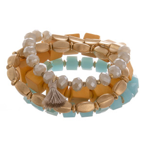 "Multi layered bracelet with natural stone, wood and bead detail.  Approximate 6"" in length."