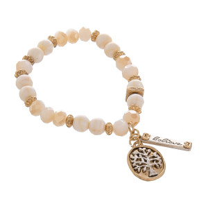 """Natural stone and bead stretch bracelet with charms. Approximate 6""""  in length."""