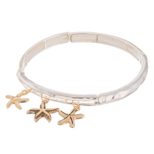 """Metal bracelet with starfish charms. Approximate 6"""" in length."""