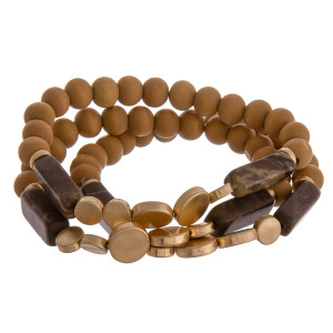"Multi strand natural stone bracelet with wood and beads. Approximate 6"" in length."