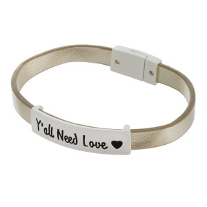 """Faux leather bracelet featuring """"Y'all Need Love"""" focal with a magnetic clasp closure. Approximately 2.5"""" in diameter. Fits up to a 5"""" wrist."""