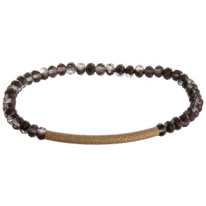 """Iridescent beaded stretch bracelet featuring a gold focal accent. Approximately 3"""" in diameter unstretched. Fits up to a 6"""" wrist."""