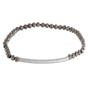 """Iridescent beaded stretch bracelet featuring a silver focal accent. Approximately 3"""" in diameter unstretched. Fits up to a 6"""" wrist."""