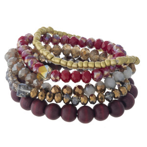 """Beaded stretch bracelet set featuring wood, faceted and gold plastic bead details. Approximately 3"""" in diameter unstretched. Fits up to a 6"""" wrist."""
