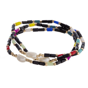 """Beaded bracelet set featuring three stretch bracelets with iridescent bead details and pearl accents. Approximately 3"""" in diameter unstretched. Fits up to a 6"""" wrist."""