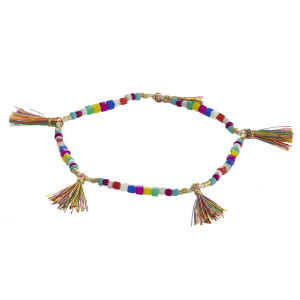 """Beaded stretch bracelet featuring square faceted bead details with tassel accents. Approximately 3"""" in diameter unstretched. Fits up to a 6"""" wrist."""