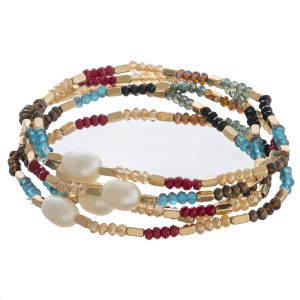 """Faceted beaded stretch bracelet set with gold and pearl bead accents. Approximately 3"""" in diameter unstretched. Fits up to a 6"""" wrist."""