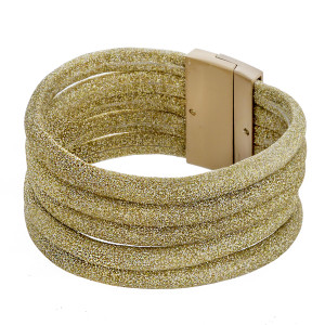 """Multi strand faux leather metallic bracelet with magnetic closure. Approximately 3"""" in diameter and 1"""" in width. Fits up to a 6"""" wrist."""