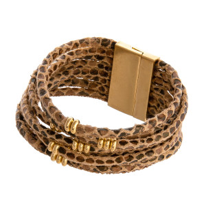 "Multi strand faux leather snakeskin bracelet featuring gold accents and a magnetic closure. Approximately 3"" in diameter. Fits up to a 6"" wrist."
