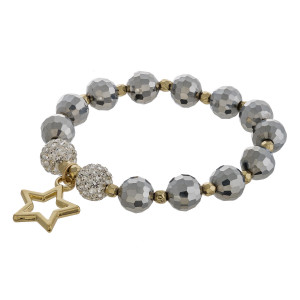 """Beaded star stretch bracelet featuring rhinestone accents. Approximately 3"""" in diameter unstretched. Fits up to a 6"""" wrist."""